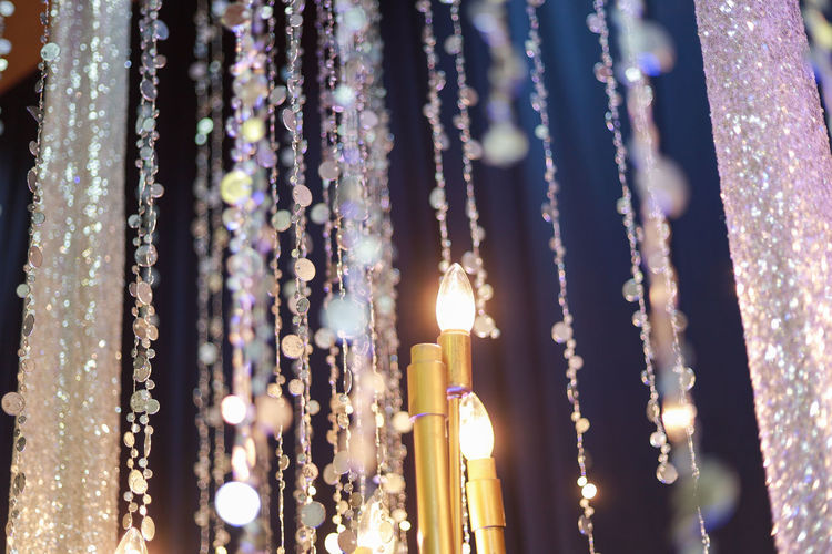 No People Illuminated Close-up Hanging Selective Focus Decoration Focus On Foreground Lighting Equipment Glowing Crystal Outdoors Nature Night Candle Curtain Large Group Of Objects Burning Jewelry Purple