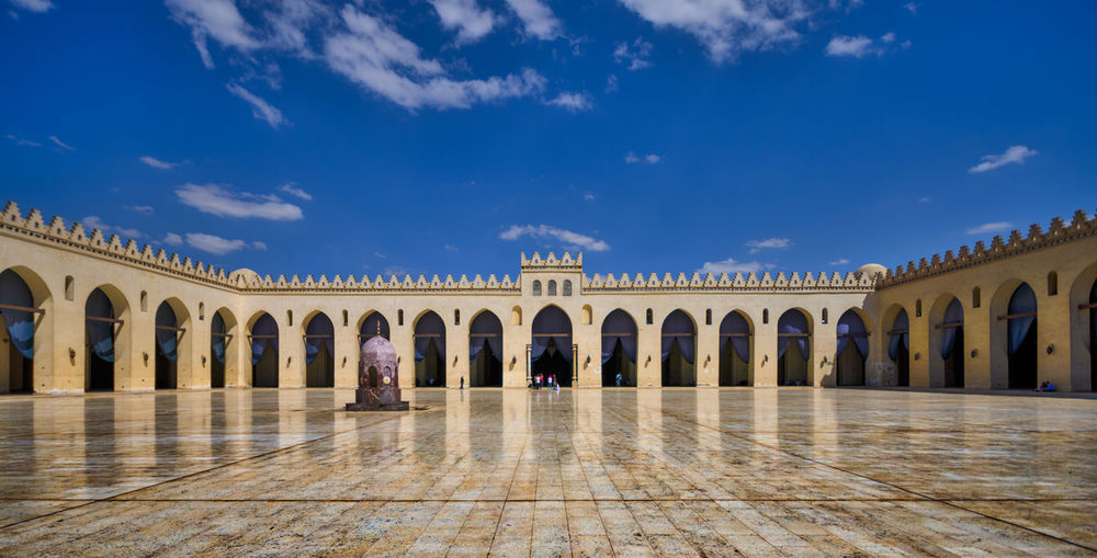 Panoramic view of al-hakim mosque against blue sky
