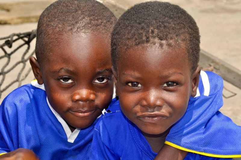 Close-up portrait of smiling brothers