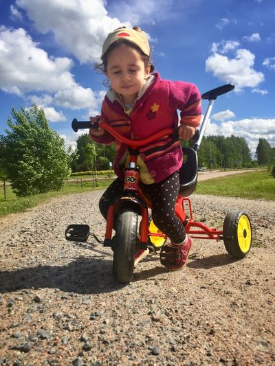 Diligence Tricycle Toddler  Toddler Girl Childhood One Person Full Length Day Cloud - Sky Real People Outdoors Sky Playing Leisure Activity Tree Casual Clothing Park - Man Made Space Field Lifestyles Sunlight Elementary Age Helmet Nature