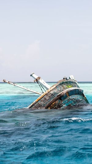 Shipwreck Sea Water Nautical Vessel Transportation Mode Of Transportation Sky Going Remote Nature Horizon Over Water Ship No People Abandoned Travel Beauty In Nature Waterfront Deterioration Scenics - Nature Horizon Outdoors Day Motion