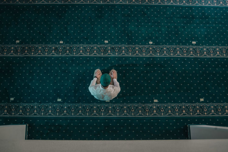 High angle view of people sitting by swimming pool