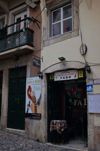 Fado Portugal EyeEm City Lover Streets Of Lisbon Lissabon, Portugal Lisboa Portugal Lisbon - Portugal Alfama Built Structure Architecture Building Exterior Communication Text No People Building City Day Graffiti Sign Window Outdoors Residential District Entrance Street Door