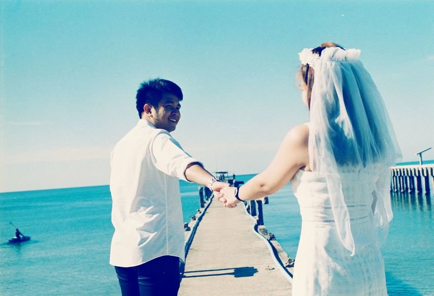Wedding Sea Two People Beach Wedding Sky Outdoors People Human Body Part Multi Colored Water Film Analog Nature Photography Dreamscapes & Memories Filmisnotdead Filmisalive Filmphotography Natural Light Portrait Love Highlights Portrait Rear View Beautiful Woman Filmmaking The Portraitist - 2017 EyeEm Awards EyeEmNewHere