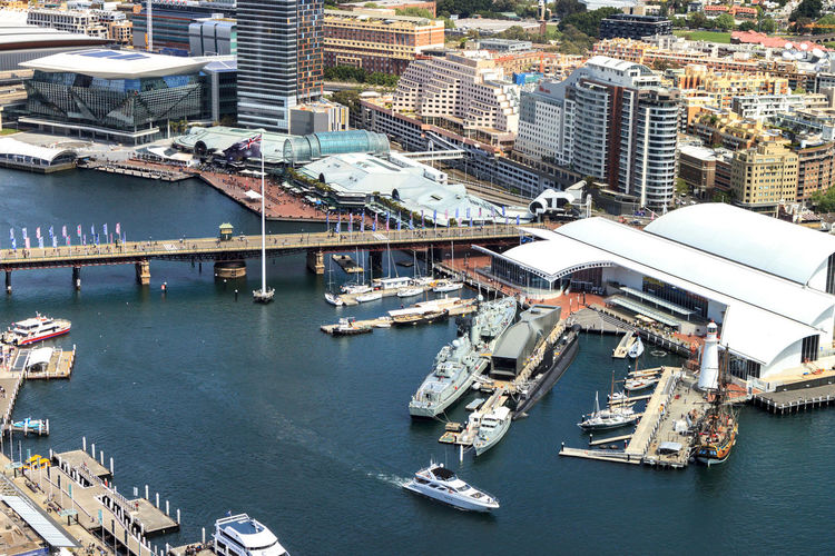 Darling Harbour, showing the bridge and the moored military ships belonging to the Maritime Museum Cityscape Darling Harbour Architecture Building Exterior Built Structure City Cityscape Commercial Dock Day Harbor High Angle View Mode Of Transport Moored Nautical Vessel No People Outdoors Transportation Water Waterfront
