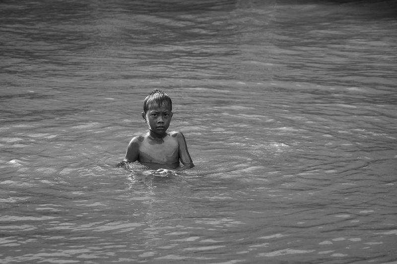 Water Swimming Lifestyles One Person Leisure Activity Vacations Outdoors Boys Waterfront Swimming Pool Day Childhood One Boy Only Real People Summer Sea Nature Portrait Child Children Only Eyeem Market EyeEm Best Shots EyeEm Selects Stockphoto