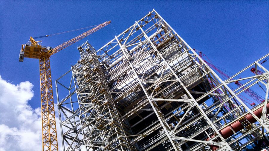 Colossal structure Low Angle View Construction Site Day Built Structure Blue Architecture Outdoors Construction Frame No People Sky