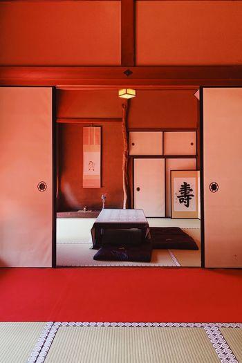 Interior of empty room with red door