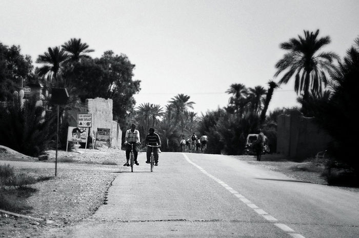 Telling stories differently friends bicycling chatting telling a story friendship blackandwhite photography black and white depth