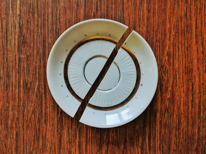 Close-up of broken saucer on table