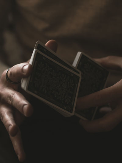 Close-Up Of Man Holding Cards
