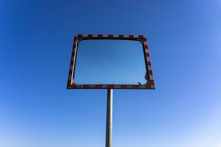 Berlin, Germany, October 13, 2018: Low Angle View of Old Rectangular Curved Traffic Mirror Against Blue Sky Berlin Germany 🇩🇪 Deutschland Color Image Horizontal Outdoors No People Blue Sky Low Angle View Clear Sky Copy Space Single Object Blank Rectangle Absence Rectangular Traffic Mirror Backgrounds Copy Space Blue Sky Convex Curved  Reflection Pole Mirror