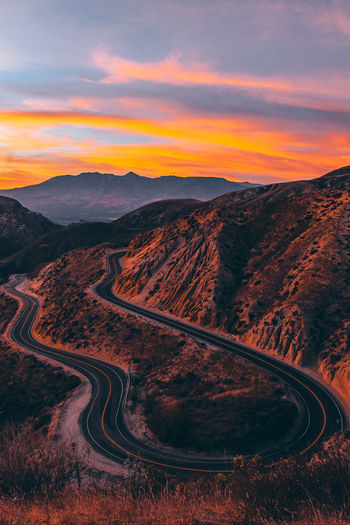 Winding Road Against Sky During Sunset