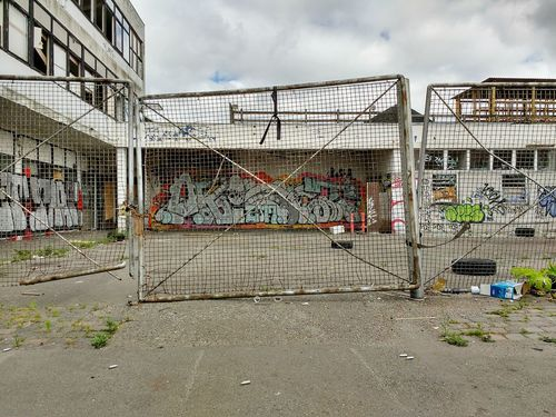 Urbandecay Graffiti Architecture Building Exterior Built Structure Outdoors No People Ghetto Sky Day Signofthetimes Locked Gate Grey Texture And Surfaces Urbanphotography Forgotten Places  Full Frame Wasteground Wasteland Architecture Eattherich Forgottenspaces Backgrounds Metal Derilict Building