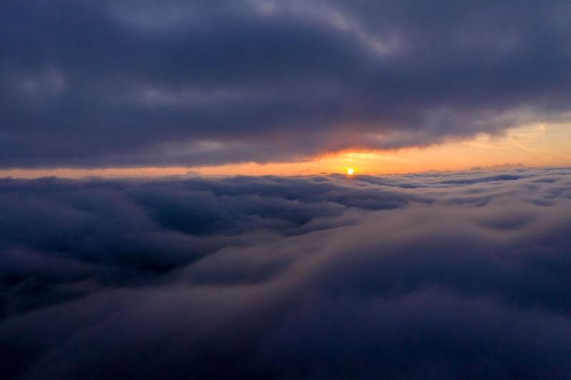 Sunrise above a sea of clouds, salzburg, austria