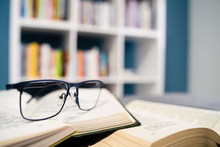 Publication Book Glasses Eyeglasses  Education Learning Table Still Life Indoors  Literature Wisdom Close-up Shelf Paper Bookshelf Selective Focus No People Studying Expertise Textbook Reading Glasses Personal Accessory Eyewear