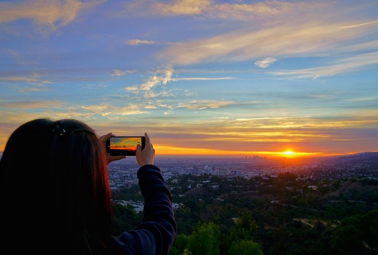 Sunset over LA. My USA Journey Landscape Sunset California Calm Taking Photos City Horizon Over Land Sky Los Angeles, California Sunset Sunset Silhouettes Landscape_Collection Girl Sony Vacations EyeEm Best Shots EyeEm Nature Lover EyeEm Selects EyeEm Gallery EyeEm EyeEmBestPics Eyeemphotography Woman Idyllic Tranquility Tranquil Scene Scenics Scenics - Nature Travel Travel Destinations Sky And Clouds USA Human Hand Photo Messaging City Wireless Technology Photography Themes Technology Cityscape Photographing Sunset Device Screen Digital Viewfinder Office Building Dramatic Sky Residential District Calm Residential Structure Atmospheric Mood