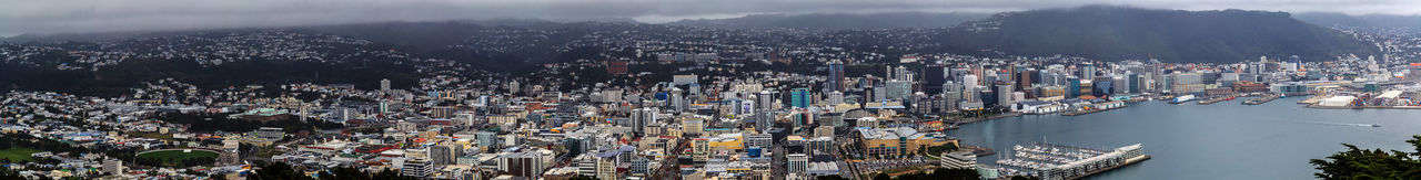 Wellington /ˈwɛlɪŋtən/ (Māori: Te Whanganui-a-Tara) is the capital city and second most populous urban area of New Zealand, with 405,000 residents.[3] It is at the south-western tip of the North Island, between Cook Strait and the Rimutaka Range. https://en.wikipedia.org/wiki/Wellington Wellington Harbour Clouds Day High Angle View Outdoors Panoramic Sky Tree Wellingtonnz