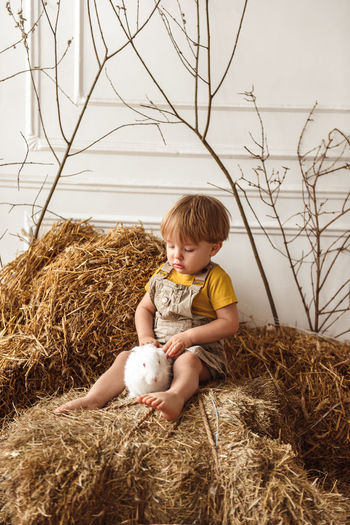 Full length of cute baby boy against plants