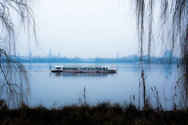 new years silence.. Außenalster Beauty In Nature Boat Cityscapes Enjoying The View Eye4photography  Fog Hamburg January2016 Lake Lake View Lakeshore Lakeside Mood Moody Sky Neujahr NewYear Open Edit Reflection Reflection River Urban Nature Water Water Reflections Waterfront