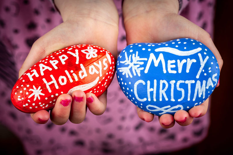 Girl holding painted rocks with Happy Holidays and Merry Christmas lettering closeup Christmas Happy Holidays! Holidays Merry Christmas! Rock Painting Blue Body Part Child Childhood Close-up Communication Emotion Finger Focus On Foreground Greetings Hand Heart Shape Holding Human Body Part Human Hand Indoors  Lettering Lifestyles Message Nail One Person Painted Rock Polka Dot Positive Emotion Real People Red Text Western Script