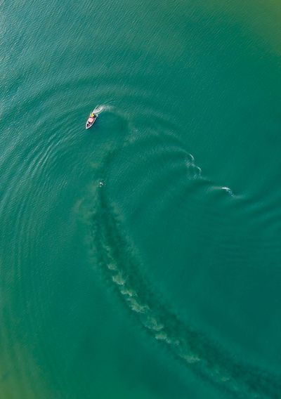 Aerial view of boat in turquoise sea