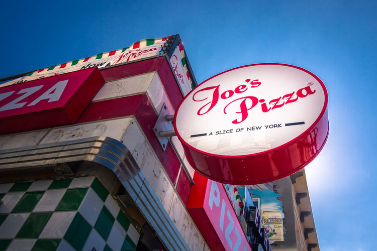Low Angle View Building Exterior Day Clear Sky Building Text Sky Sunlight Pizza Sign