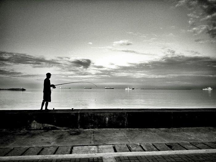 Fishing in the Morning Bay Black Eyeem Philippines EyeEm Philippines Manila Meetup Fishing Boat Manila Bay  Philippiines Streetphotography Urban The Street Photographer - 2016 EyeEm Awards The Photojournalist - 2016 EyeEm Awards