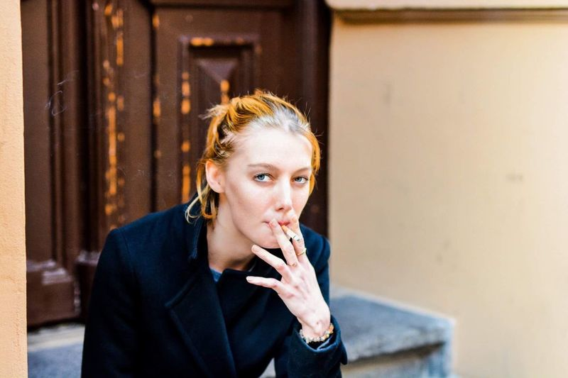 Young Woman Smoking Cigarette