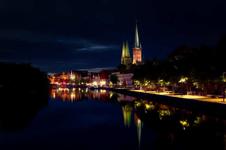 St Mary Church Amidst Illuminated Houses By River At Night