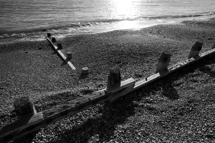 Angle Groynes Black & White Angle Beach Beauty In Nature Blackandwhite Day Groynes Nature No People Outdoors Sea Sunlight Tranquility Water Wave