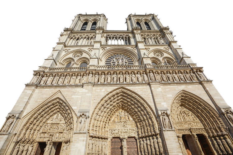 Notre Dame de Paris central main facade, national monument cathedral of France. French Gothic architecture. isolated on white background and copy space. Notre Dame De Paris Notre Dame De Paris Exterior Paris Church Cathedral France Isolated Isolated White Background Isolated On White Architecture Low Angle View Built Structure Arch Building Exterior Sky The Past Place Of Worship Religion History Belief Travel Destinations Spirituality No People Day Building Clear Sky Travel Outdoors Ornate Gothic Style