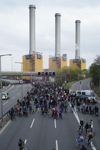 Group of people on road against buildings