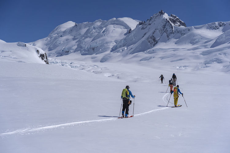 People skiing on snowcapped mountain