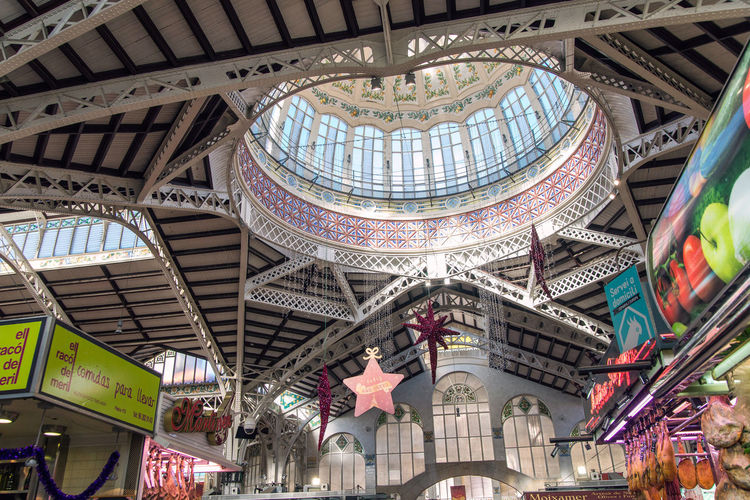 interior of Valencia market Built Structure Architecture Low Angle View Ceiling Indoors  Travel Destinations Travel Tourism Text Day Shopping Mall Dome Arch No People City Hanging Pattern Ornate Market Interior Valencia, Spain