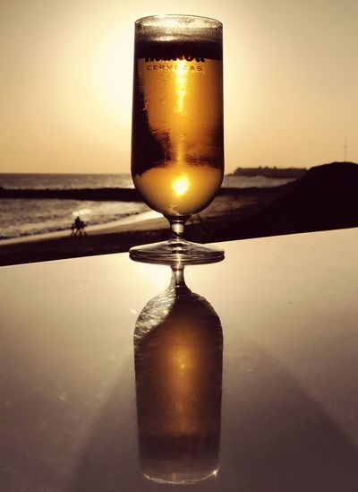 Sunset Sea Sky Gold Colored No People Alcohol Outdoors Close-up Reflection