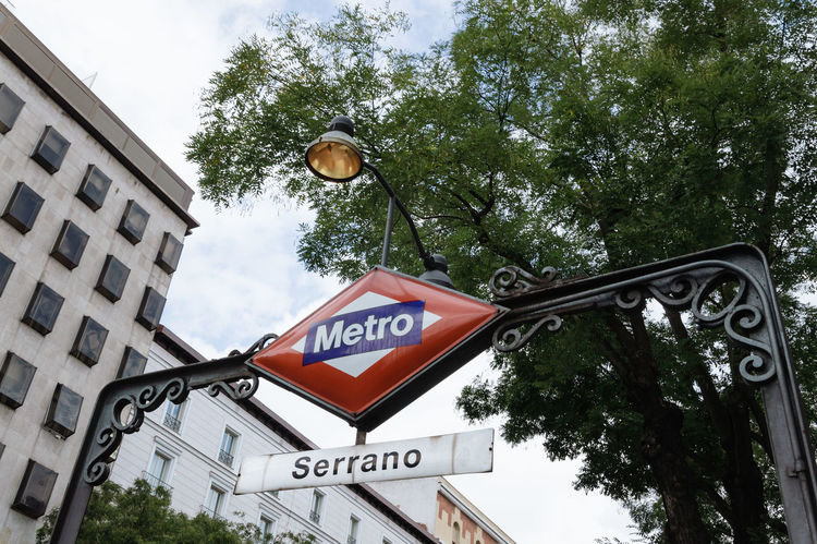 Metro station in Madrid. Low angle view of sign Architecture Capital Cities  City City City Life Cityscape Day European  Information Sign Low Angle View Madrid Metro Metro Station No People Outdoors Road Sign Serrano Sky SPAIN Subway Subway Station Text Underground Urban Urban Skyline