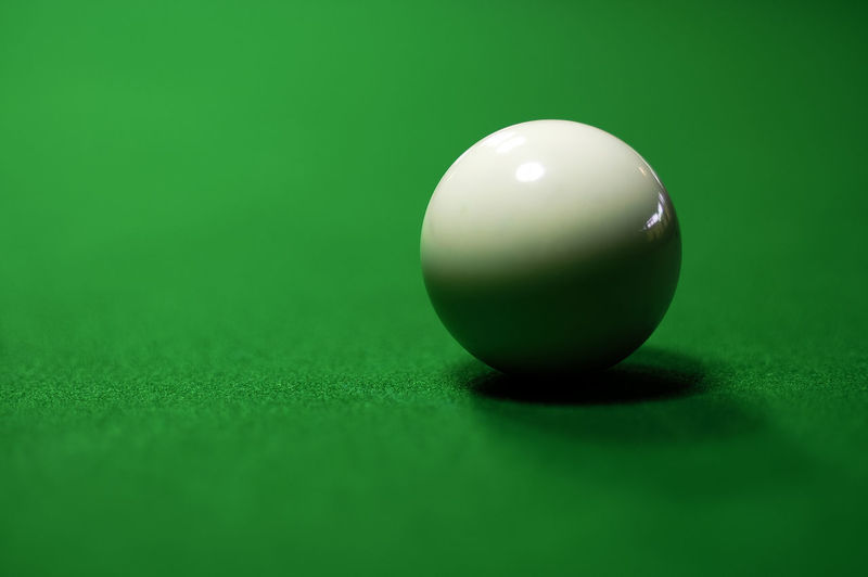 Close-up of cue ball on table