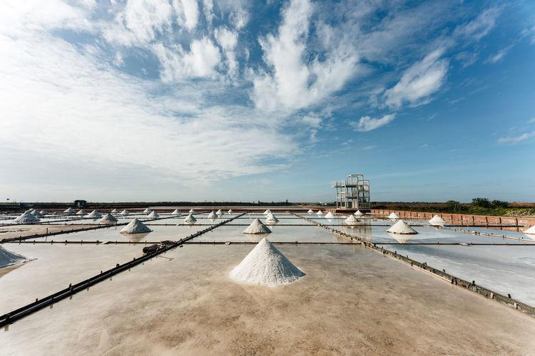 View of salt flat against sky