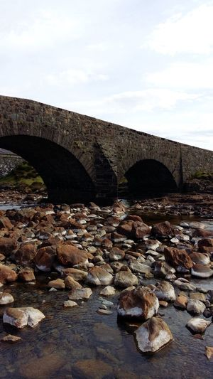 Scotland Isle Of Skye Sky Bridge Architecture Built Structure Nature Day Stone - Object Bridge - Man Made Structure Water No People Solid Arch Cloud - Sky Connection Rock River Outdoors Tranquility Rock - Object Arch Bridge