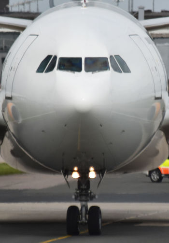 Aerospace Industry Air Vehicle Aircraft Nose Airplane Airport Close-up Commercial Airplane Front Of Airplane Illuminated Metal Mode Of Transportation Motor Vehicle No People Outdoors Public Transportation Stationary Transportation Travel