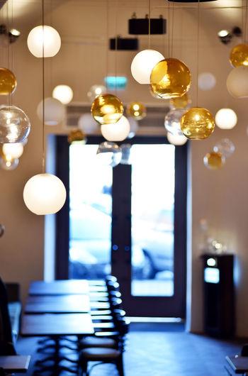 Illuminated light bulb hanging at home