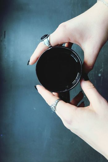 Cropped Image Of Woman Hand Holding Black Coffee In Cup