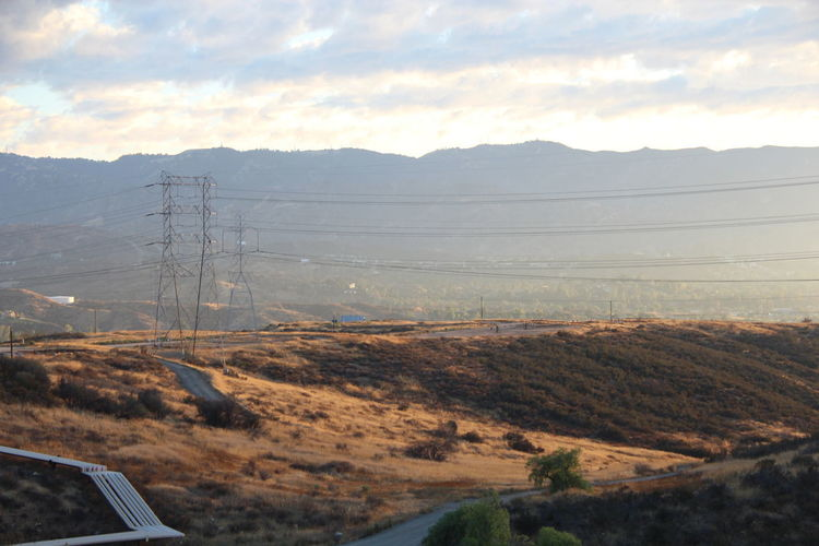 Hills Beauty In Nature Cable Connection Day Electricity  Electricity Pylon Hill Hillside Landscape Mountain Mountain Range Mountains Nature No People Outdoors Scenics Shadow Sky Technology Tranquil Scene Tranquility