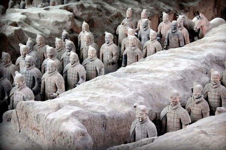 Statues by rock formations