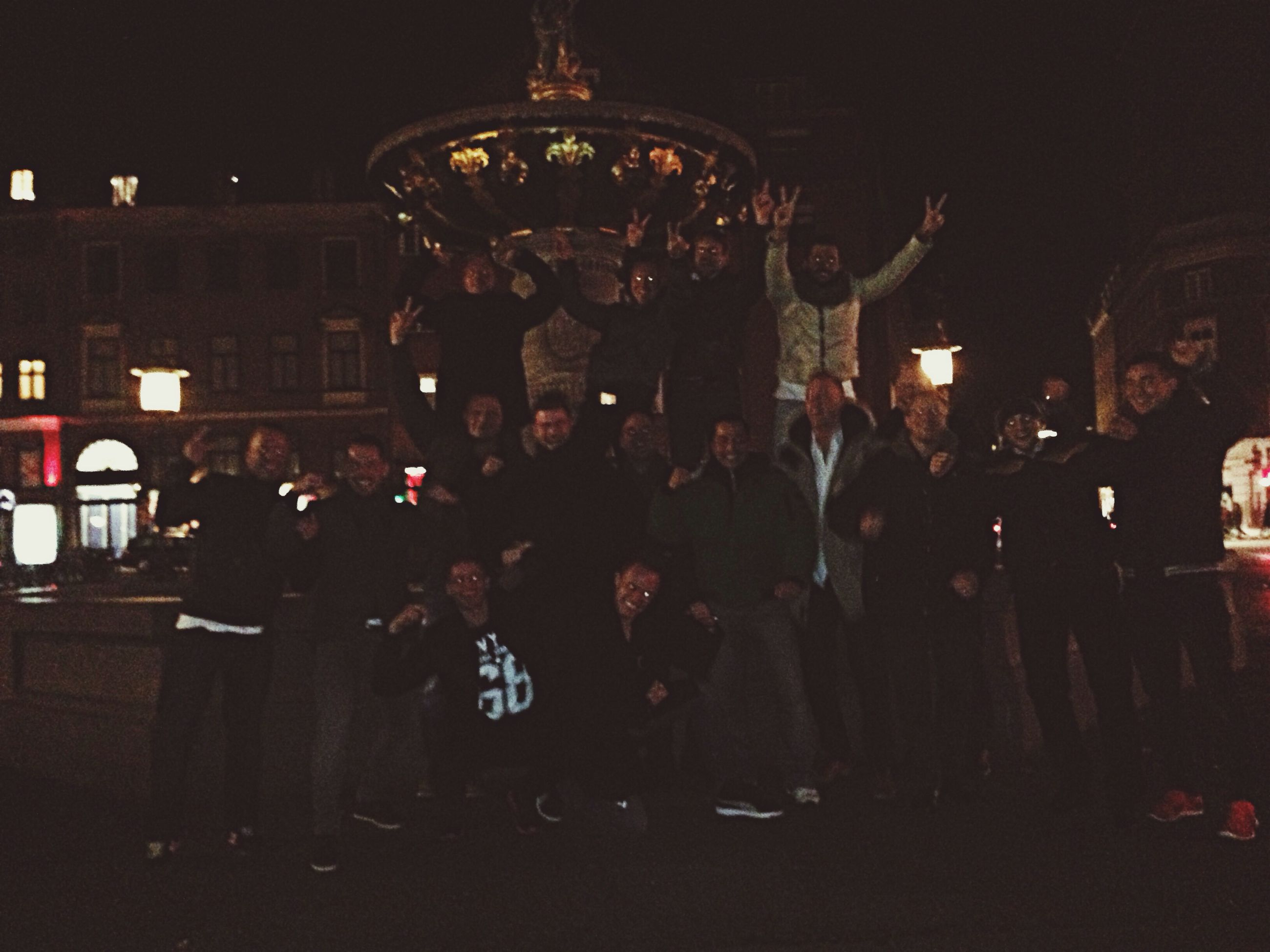 large group of people, men, night, illuminated, lifestyles, person, leisure activity, crowd, arts culture and entertainment, street, built structure, city life, architecture, indoors, music, silhouette, city, group of people, walking