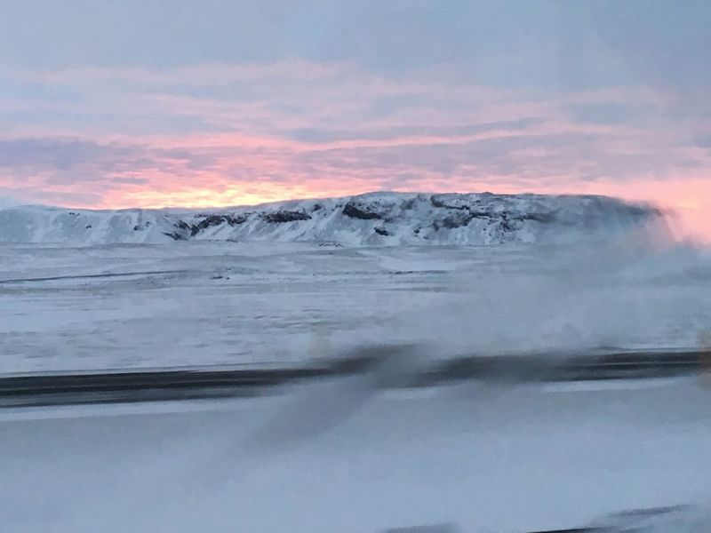 Landscape View From A Car Sunset Polar Night Frozen Landscape  Frozen Window Atmospheric Mood Blue Sky Pink Sky Mountain Iceland Roadtrip Winter Winter Adventure Beauty In Nature Snow Snowcapped Mountain Blurred Motion Blurred Dreamy Reality Romantic Sky No People Car Window Polar Winter Cold Temperature Wintertime