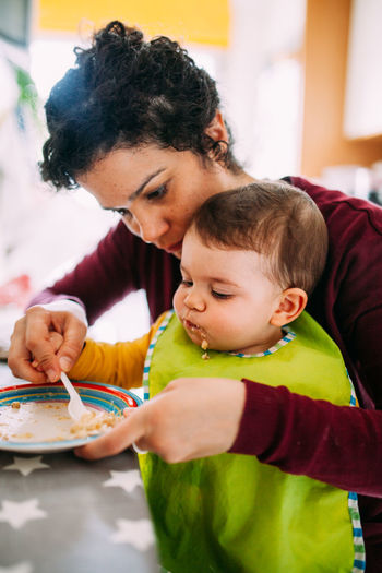 Mother & Daughter Motherhood Lifestyles Childhood Child Family Bonding Females Indoors  Parent Innocence Togetherness Mother Food And Drink Table Food Two People Eating Family With One Child Family Matters Love Healthy Eating Meal
