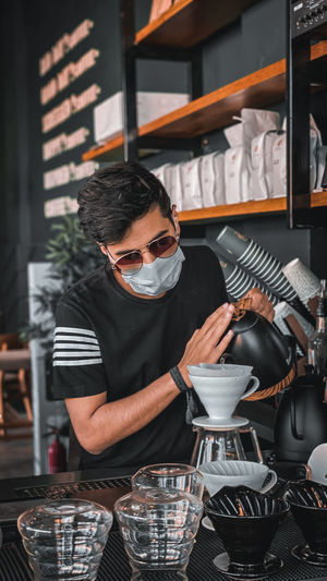 Midsection of man working at cafe