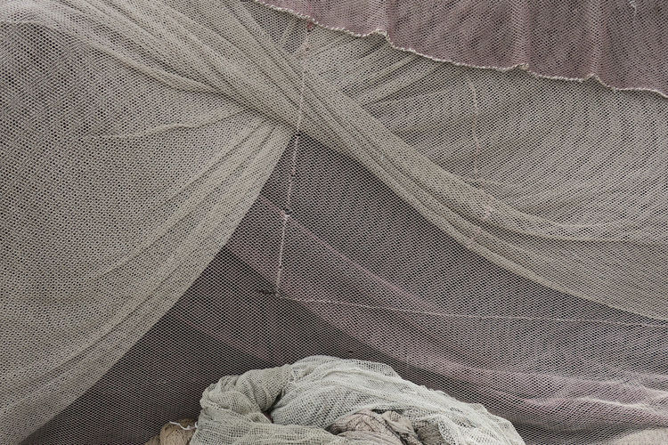 gray colored fishing nets Beautiful Fishing Net Textiles Backgrounds Cloth Crumpled Fabric Fiber Gray Color Material Messy No People Pattern Still Life Structure Textile Wrinkled
